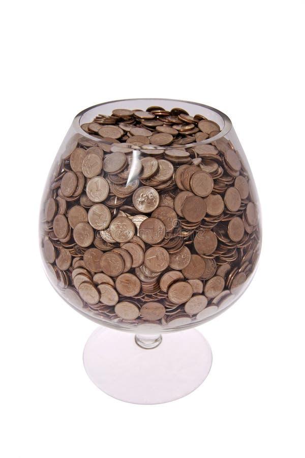 Glas met geld royalty-vrije stock afbeeldingen