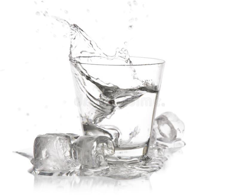 Glas met plons stock foto's