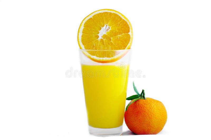 Glas met sap en rijpe sinaasappel. royalty-vrije stock foto