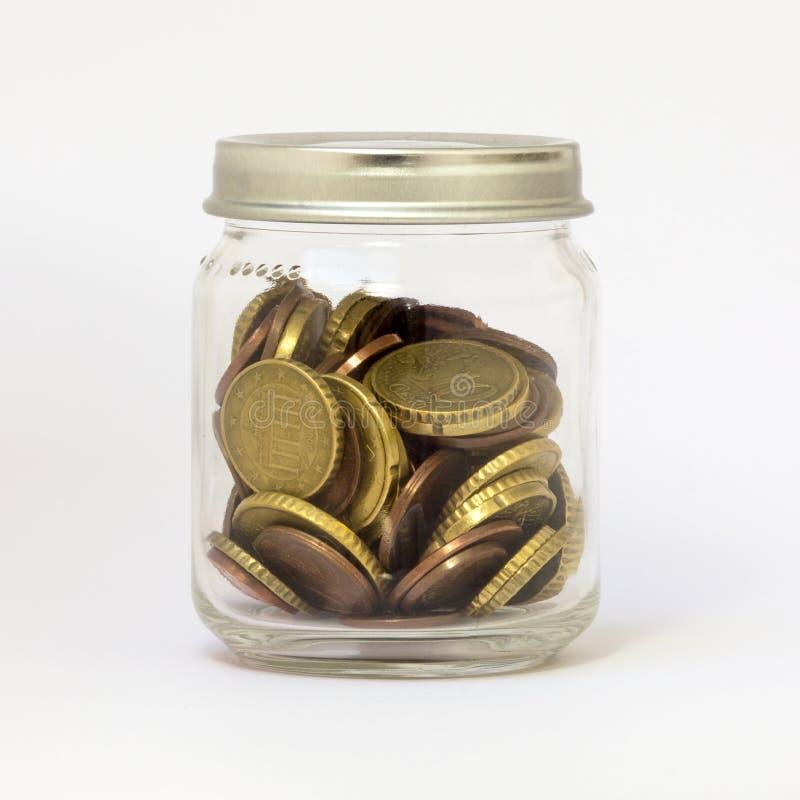 Glas mit Geld-kleiner Veränderung stockfoto