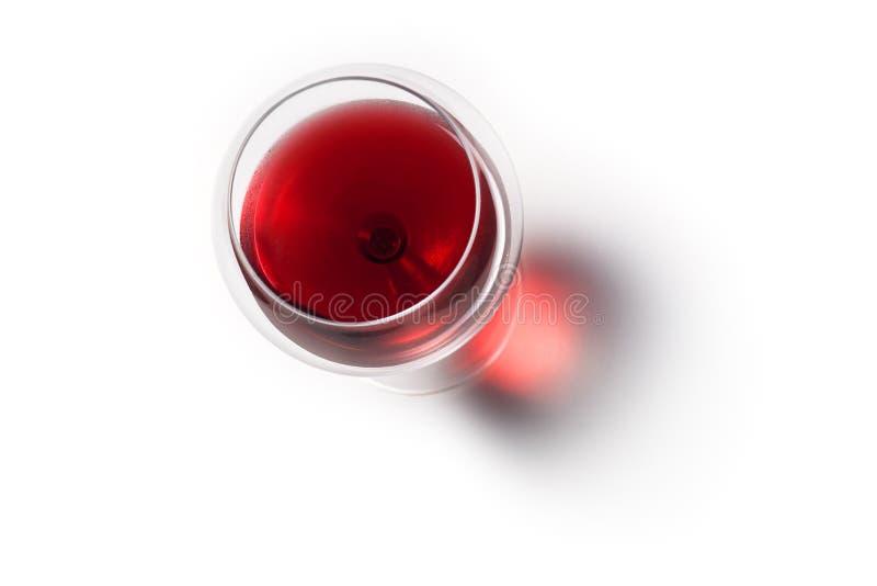 Glas rode wijn met schaduw Hoogste mening stock afbeelding
