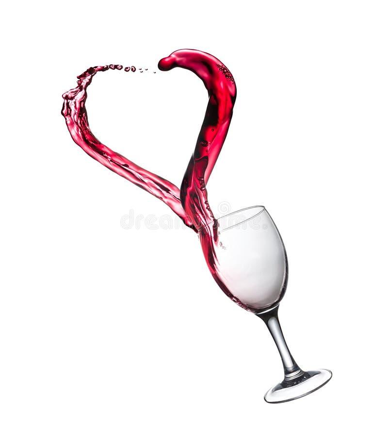 Glas Rotwein-Zusammenfassungs-Herz-Spritzen lizenzfreies stockbild