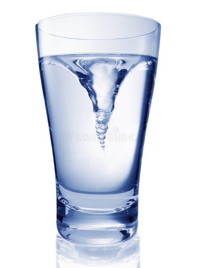 glas som vrider vatten royaltyfria bilder