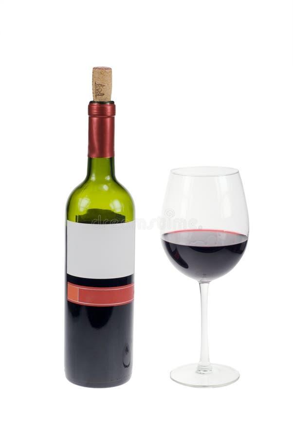 Glas und Flasche Rotwein lizenzfreies stockbild