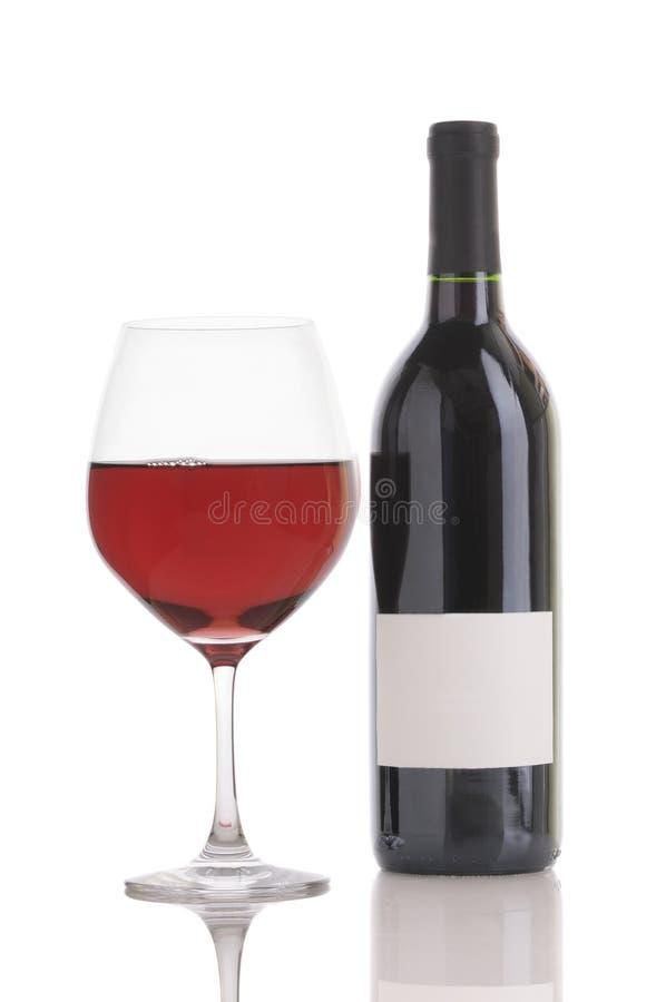 Glas van Rode Wijn en Fles stock fotografie