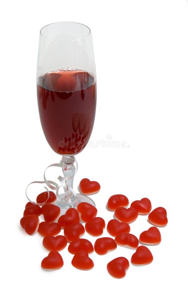 Glas van wijn en hart stock fotografie