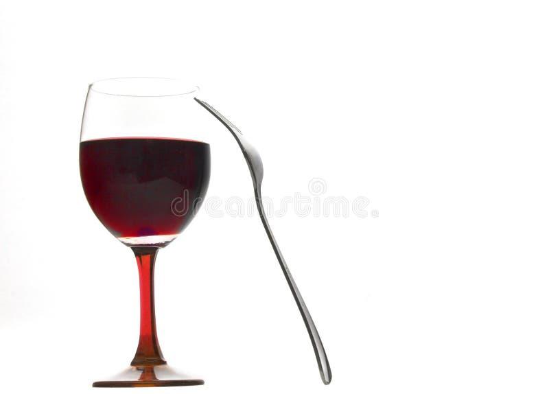 Glas Wein mit einer Gabel stockfoto