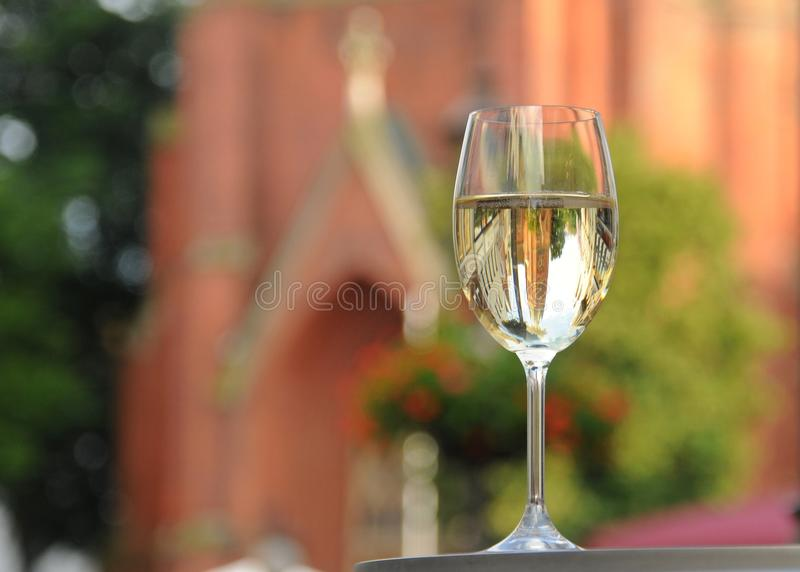 A glas of white wine on the marketplace stock photos