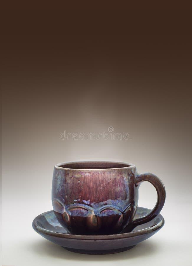 Glasad lera rånar med kaffe arkivbild