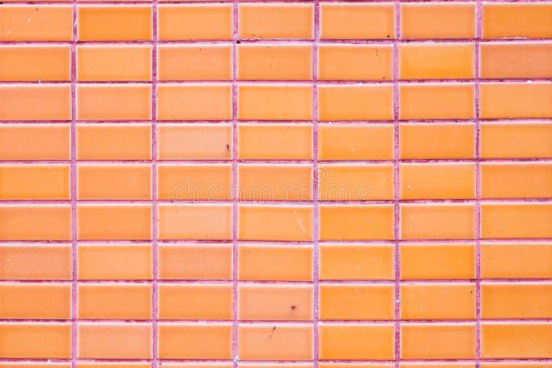 Glasade tegelplattor för vägg apelsin arkivfoton