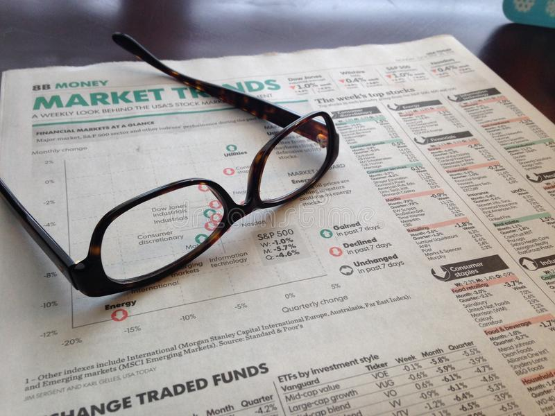 Glases on Financial paper. Morning look at the markets with a financial paper stock images