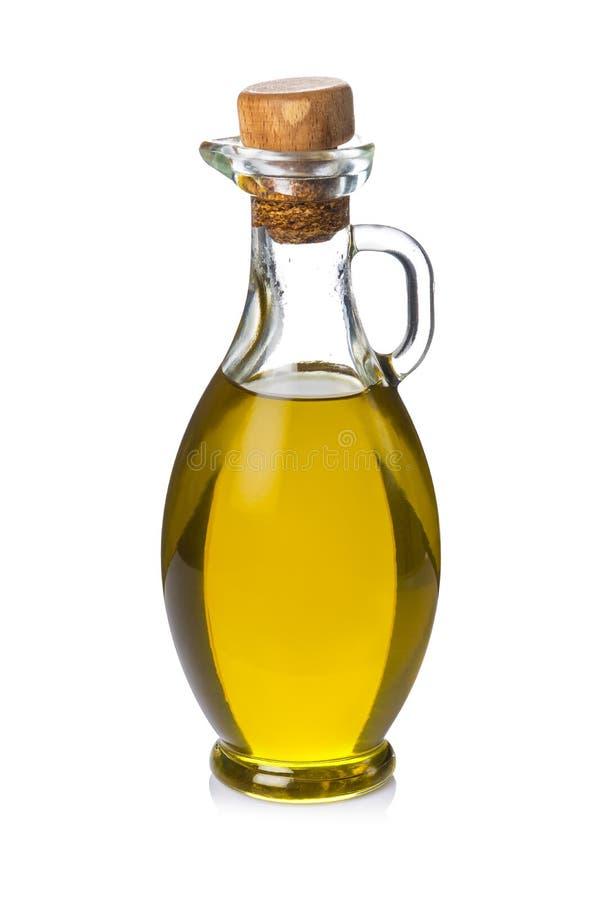 Glasflasche mit dem Olivenöl lokalisiert auf weißem Hintergrund lizenzfreie stockfotos