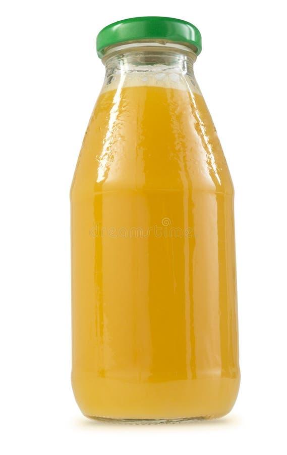 Glasflaska av orange fruktsaft royaltyfria foton