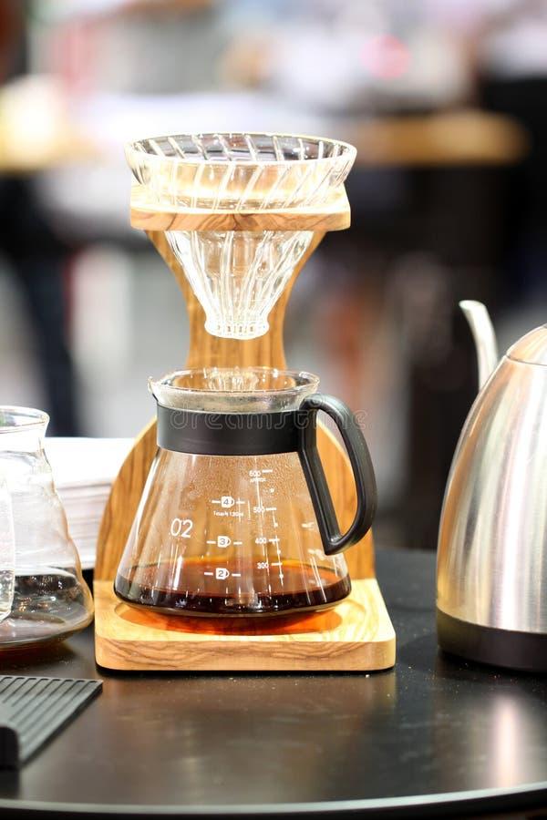 Glasflaska för kaffekopp arkivbild
