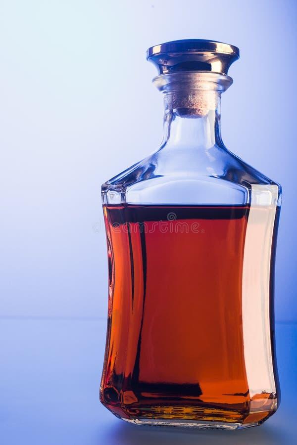 Glasfles cognac royalty-vrije stock foto
