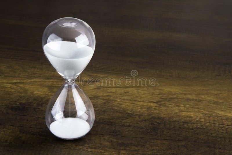 Glasgegenwartkonzept der Stunde stockfoto