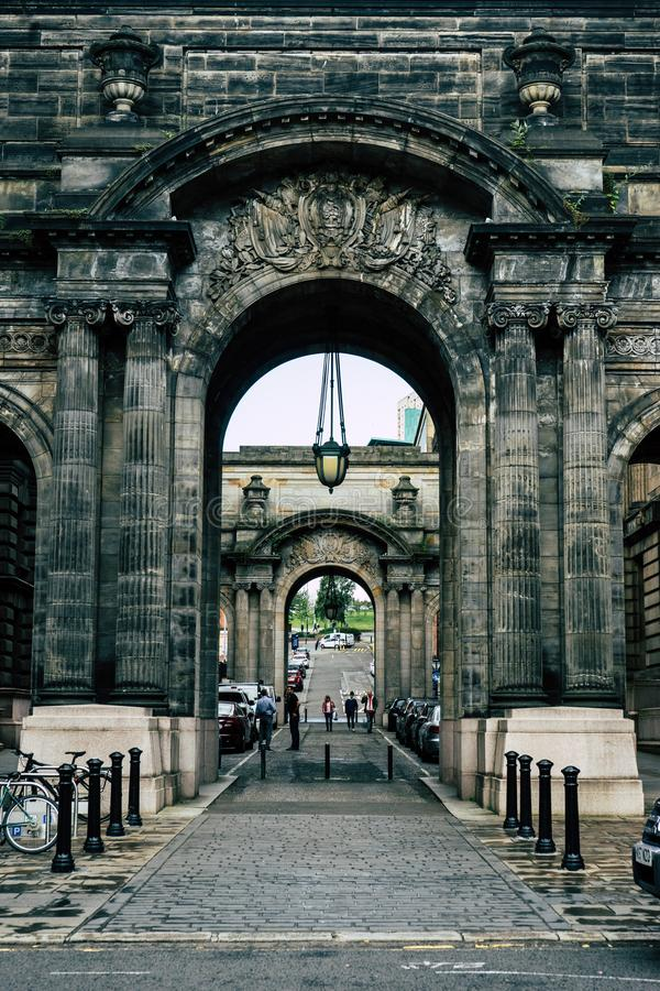 Glasgow City Chambers Sandstone Arches. The arches at the back of the Glasgow City Council Chambers featuring impressive sandstone carvings, columns, hanging stock photo