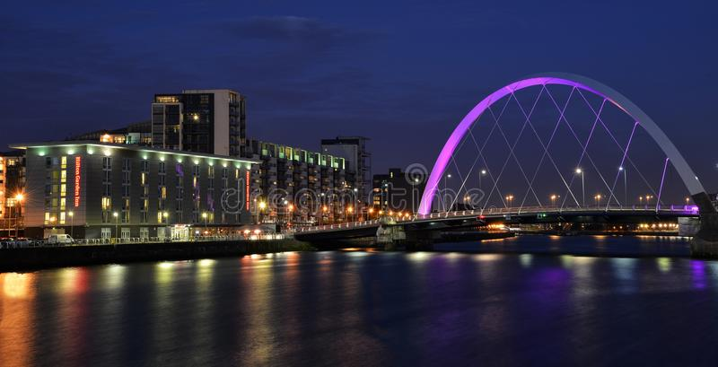 Glasgow`s Waterfront with the Glasgow Arc at dusk. Glasgow`s waterfront at dusk, showing the Glasgow Arc over the river Clyde. Locally known as `The squinty royalty free stock image
