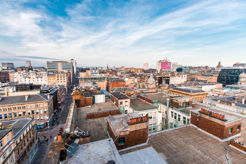 A wide view looking down on a street, buildings and rooftops in Glasgow city center, Scotland, United Kingdom. Glasgow / Scotland - February 15, 2019: A wide stock images