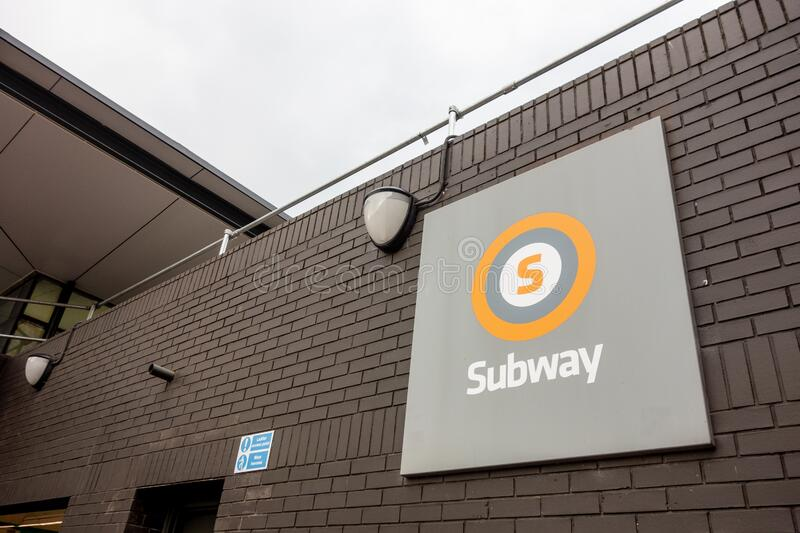 The logo of a subway underground system in Glasgow in United Kingdom above the entrance. GLASGOW, SCOTLAND - JULY 31, 2019: The logo of a subway underground royalty free stock photo