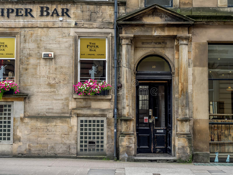 The Piper Bar in Glasgow, Scotland. Glasgow Scotland: The Piper Bar in Glasgow, Scotland. The Piper Bar is a popular pub and whisky bar across the street from royalty free stock image