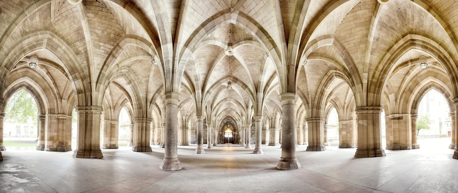 Glasgow University Cloisters panorama. The historic Cloisters of Glasgow University. Panorama of the exterior walkway. Image taken from a public position stock photo