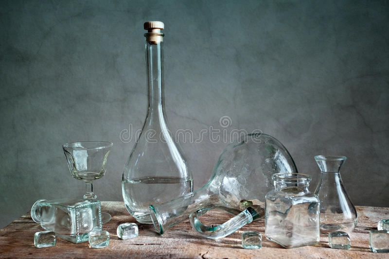 Glass. Still Life with differently shaped glass bottles royalty free stock photography