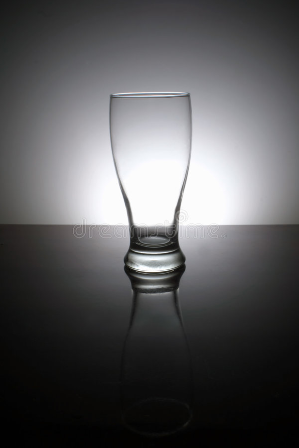 Glass. A low-key photo of empty glass royalty free stock images