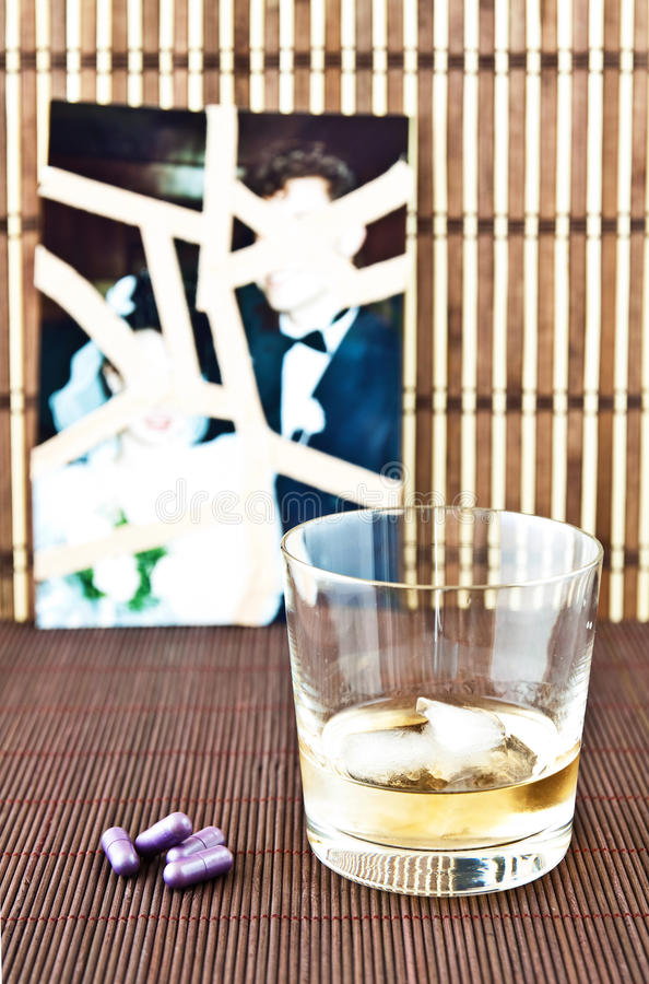 Download Glass of alcohol and pills stock image. Image of strips - 20612341