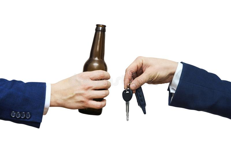 Glass of alcoholic beverage in man hand and car key in man hand. Do not drink and drive! Drunk driving. Drink and auto keys stock images