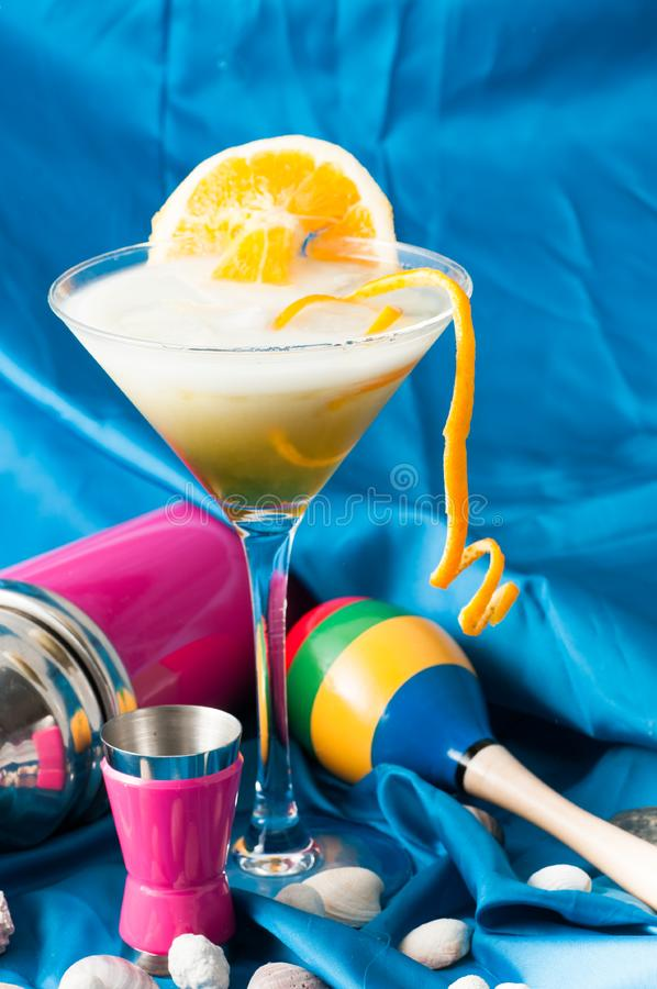 Glass of alcoholic drink cocktail with orange slices stock photos