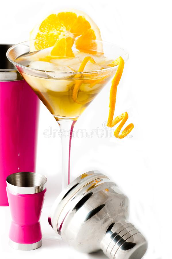 Glass of alcoholic drink cocktail with orange slices royalty free stock images
