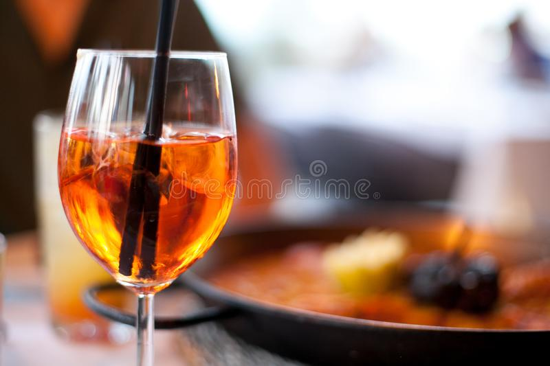 Glass of aperol spritz cocktail long drink close up, summer fresh appetizer, evening meal, dinner royalty free stock images