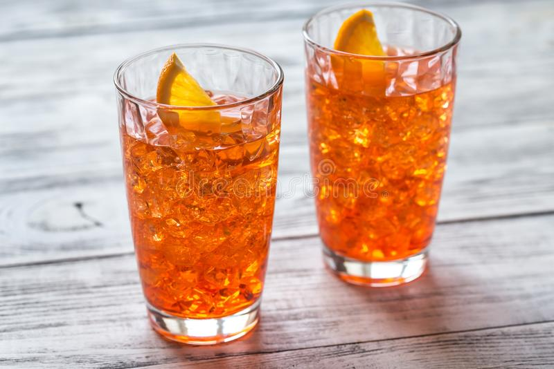 Glass of Aperol Spritz cocktail. On the white wooden background stock image