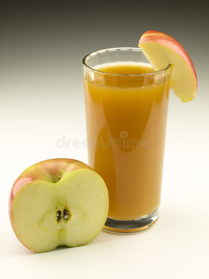 Glass of Apple Cider with Apple Pieces royalty free stock photography