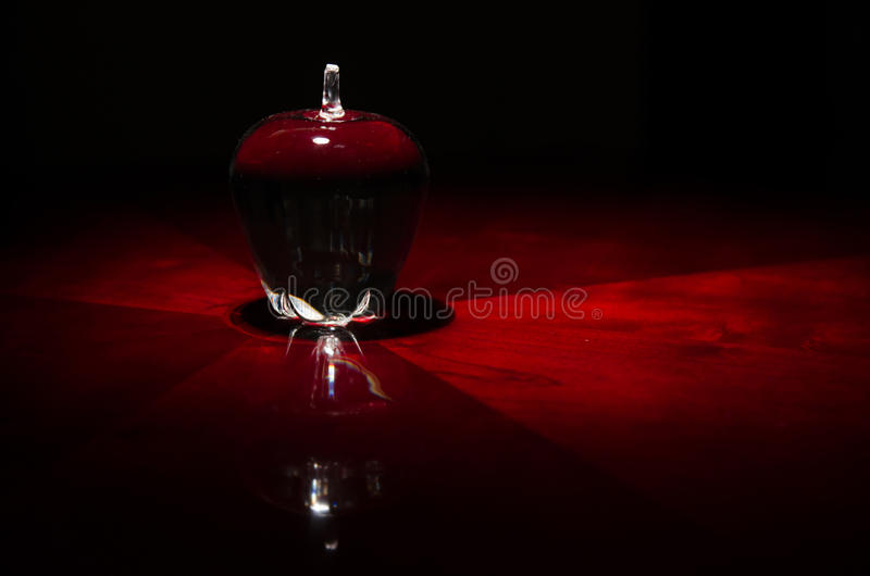 Glass Apple on Table royalty free stock image