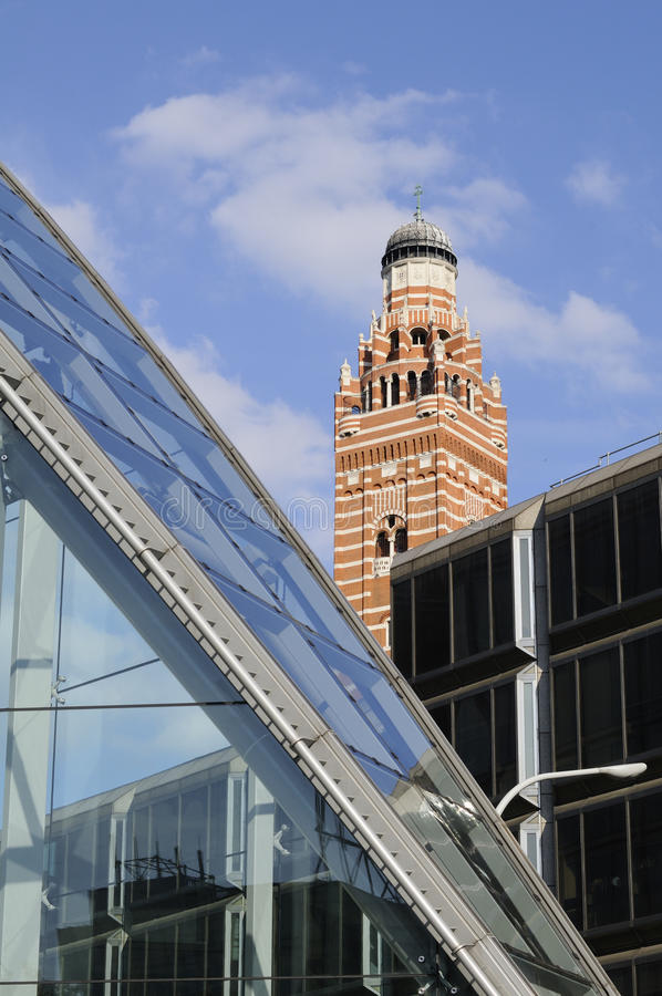 Glass architecture and church tower. Buildings expressing old and new concept royalty free stock image