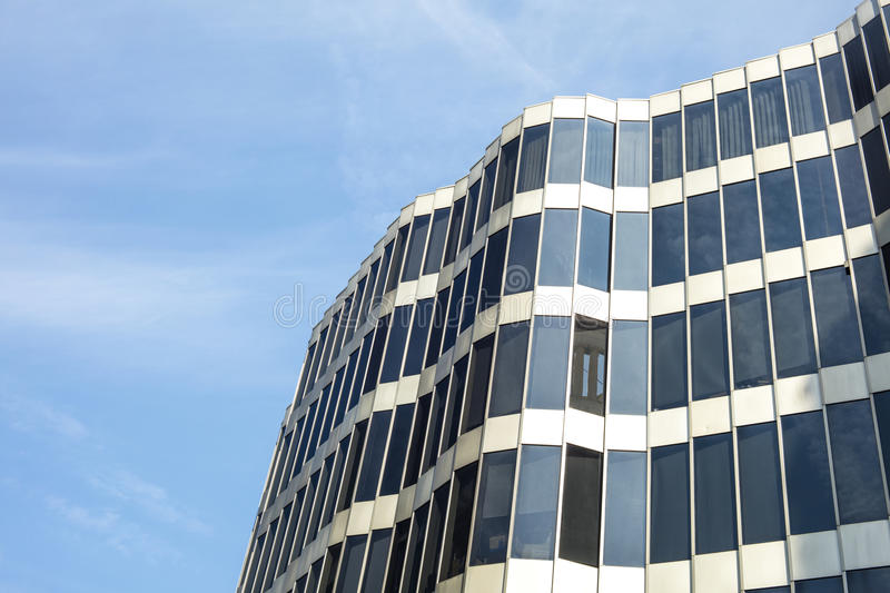 Glass architecture. Modern office building facade on a sunny day royalty free stock photo