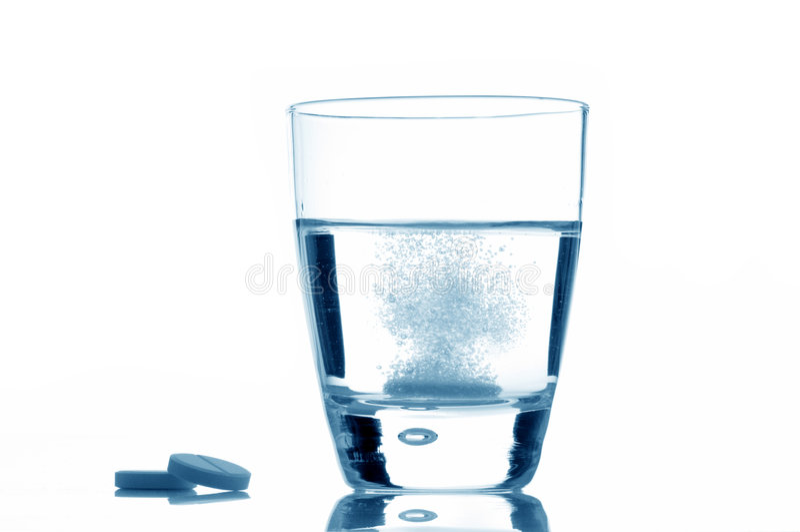Glass with aspirin stock photo