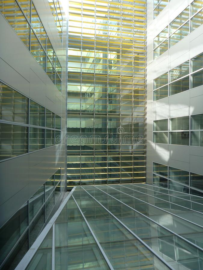 Glass atrium of a modern office buildind royalty free stock image