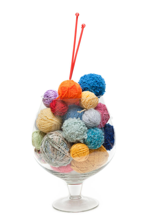Glass with ball for knitting stock photos