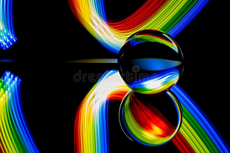 Glass ball light painting - blue green red stripes stock photo
