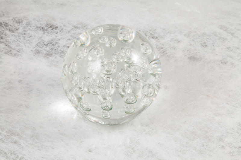 Glass ball on textured background stock images
