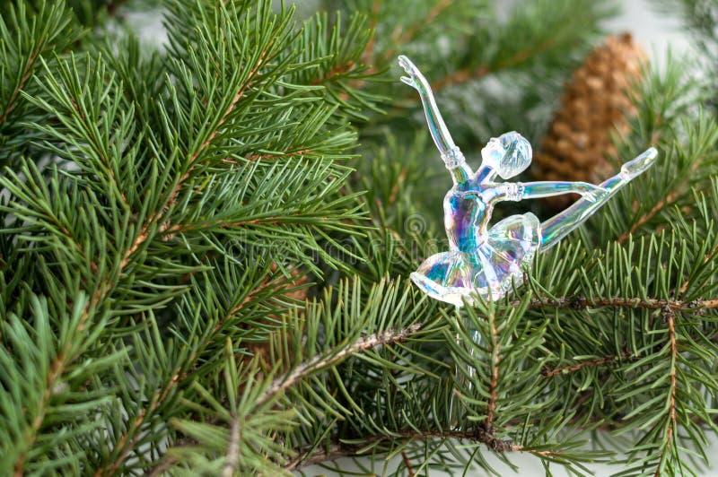 Glass ballerina decorates fir branches. stock photography