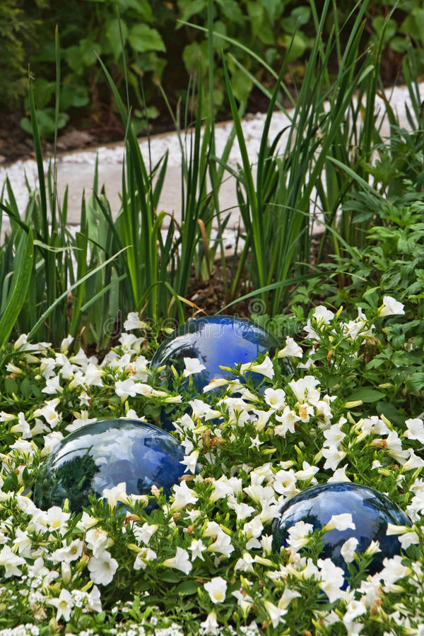 Glass balls and flowers stock photos