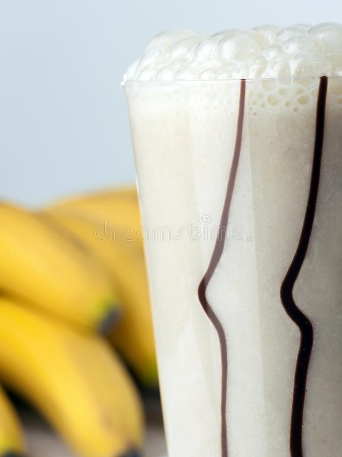 A glass of banana and milk coctail royalty free stock photography
