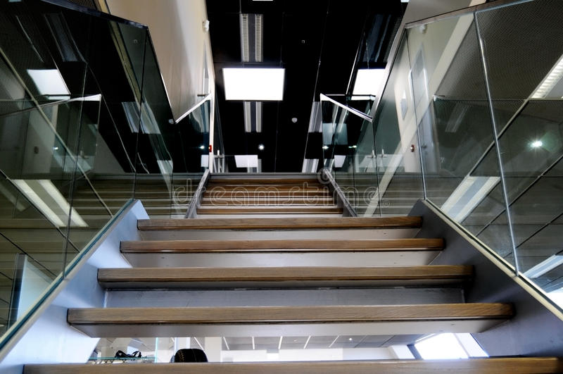 Glass banister and stairs stock photo
