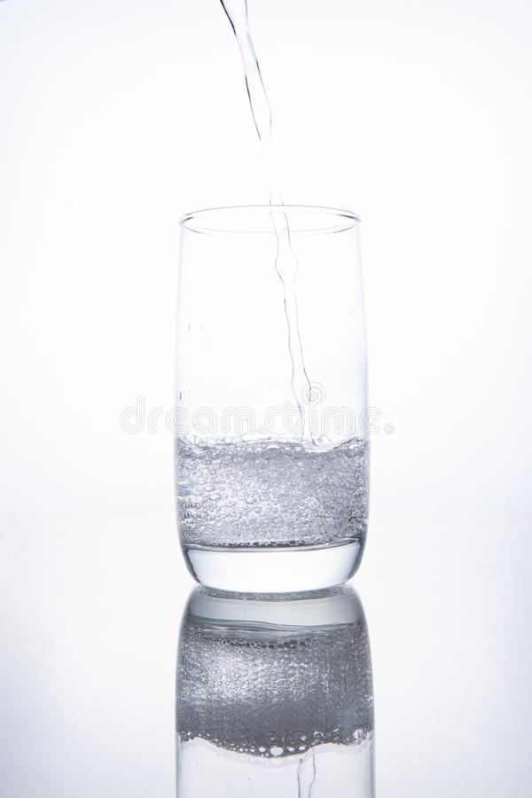 The glass beaker is filled with clear transparent mineral water royalty free stock photo