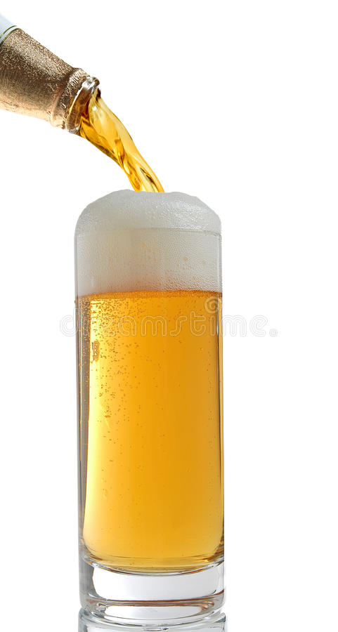 Glass of beer. Beer poured from bottle to a glass stock photos