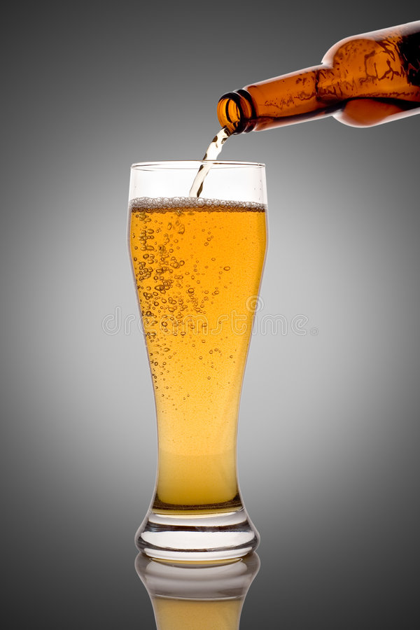 Glass of beer. Isolated against black background stock image